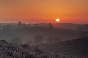 Posbank zonsopang met mist